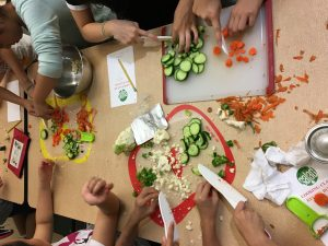 students chopping carrots and cucumbers for sauerkraut