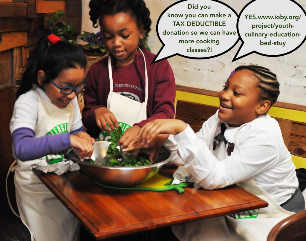 girls mixing spinach for culinary communities in bed stuy